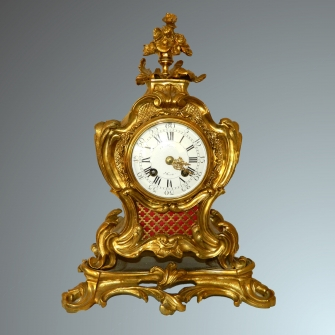 Rococo after eight mantel clock.