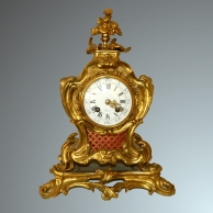 Rococo 'after eight' mantel clock.